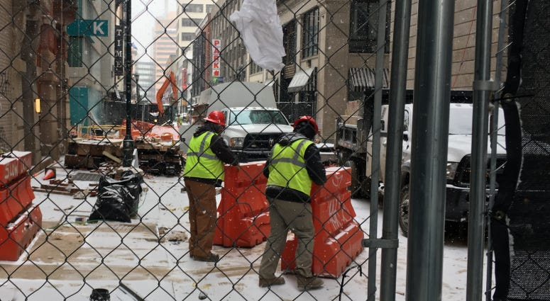 Work crews continue to repair damage done by a water main break in July on Sansom Street near Juniper.