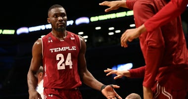 Nov 20, 2018; Brooklyn, NY, USA; Temple Owls center Ernest Aflakpu (24) reacts with teammates in the first half of the Legends Classic against the California Golden Bears at Barclays Center.