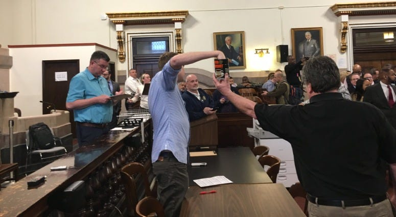 Candidates for Philadelphia city offices pick ballot positions for the May primary by picking raffle balls out of a Horn and Hardart coffee can. When a candidate isn't present and hasn't assigned a proxy, a civil servant picks from the can.