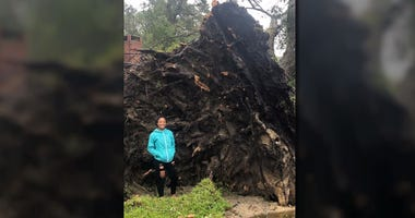 Keonna Graham, who lives in Leland, North Carolina, witnesses a fallen tree in her neighborhood.