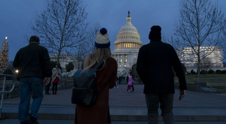 The Capitol is seen as New Year's Day comes to a close with the partial government shutdown in its second week, in Washington, Tuesday, Jan. 1, 2019.
