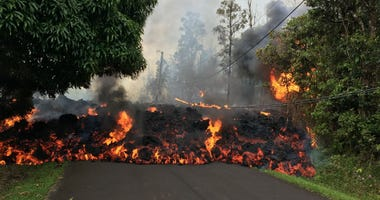 A lava flow moves on Makamae Street in Leilani Estates Sunday morning.