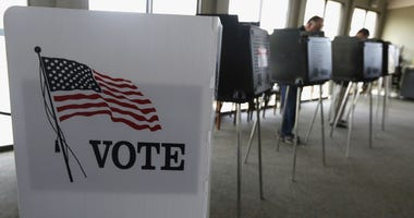 In this March 18, 2014 file photo, voters cast their ballots in Hinsdale, Ill.