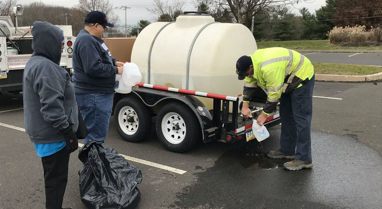 This water station is set up at the Big Oak Shopping Center in Yardley because of a boil-water advisory.