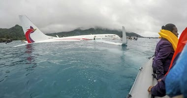 U.S. Navy Sailors from Underwater Construction Team 2 assist local authorities in shuttling the passengers and crew of Air Niugini flight to shore following the plane crashing into the sea on Friday, Sept. 28, 2018.