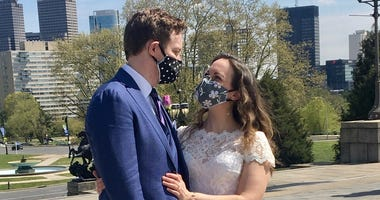 Jeremy Tackett and Callie Swanlund decided to live-stream their wedding from the Art Museum steps so guests could safely watch.
