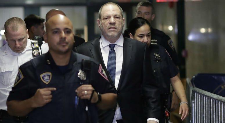 Harvey Weinstein, center, enters State Supreme Court, Thursday, Oct. 11, 2018 in New York.
