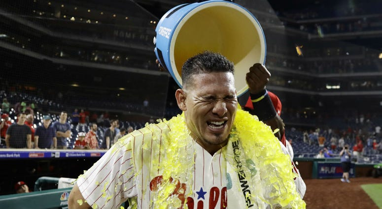 Philadelphia Phillies' Wilson Ramos is doused by Odubel Herrera after the Phillies' 7-4 win in a baseball game against the Boston Red Sox, Wednesday, Aug. 15, 2018, in Philadelphia.