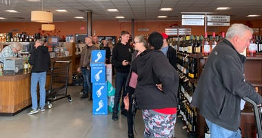 Customers descended upon the Fine Wine and Good Spirits store in Bensalem Sunday before its announced closing.