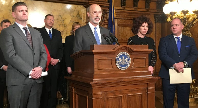Gov. Tom Wolf announces a new shale tax proposal at the state Capitol.