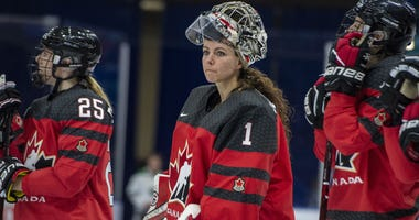 In this Nov. 10, 2018, file photo, Canada goaltender Shannon Szabados watch as U.S. players celebrate a win during the Four Nations Cup hockey gold-medal game in Saskatoon, Saskatchewan.