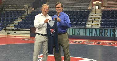Philadelphia 76ers owner Josh Harris (left) has given a $1 million gift to the wrestling program at his alma mater, the University of Pennsylvania, where Roger Reina (right) is head coach.