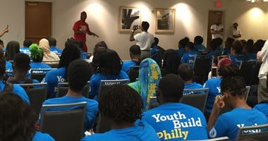 After a week of mental toughness training, 222 students committed to reclaim their education through the YouthBuild Philadelphia Charter School. New applicants completed a six-day workshop, which made up the final portion of the admissions process.