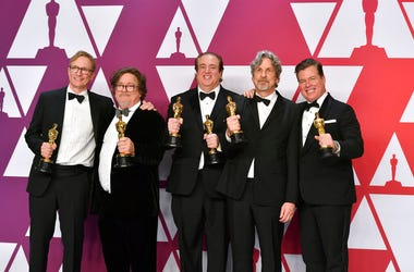 """Jim Burke, from left, Charles B. Wessler, Nick Vallelonga, Peter Farrelly, and Brian Currie pose with the award for best picture for """"Green Book"""" in the press room at the Oscars on Sunday, Feb. 24, 2019, at the Dolby Theatre in Los Angeles. (Photo by Jord"""
