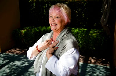 In this June 3, 2014 photo, Disney legend Russi Taylor stands amidst the long shadows at the Disney Legend Plaza at Disney Studios in Burbank, Calif. Taylor, an actress who for more than three decades gave voice to Minnie Mouse, has died on Friday, July 2