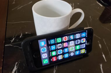 phone on coffee cup
