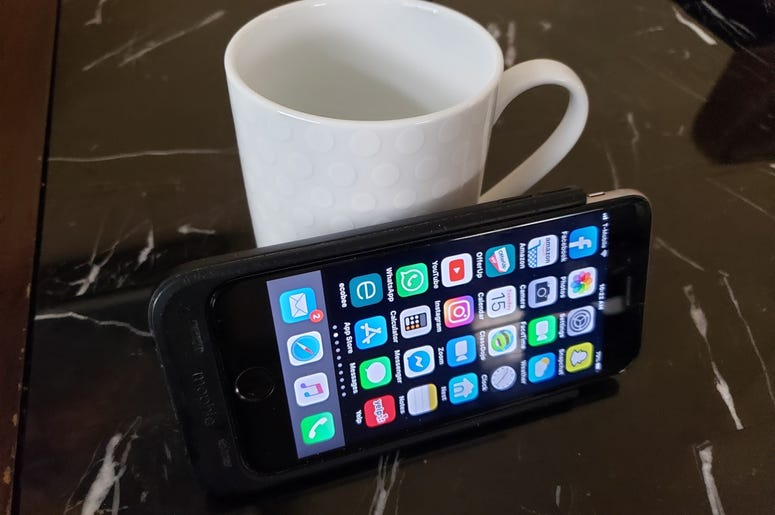 phone on coffee cup
