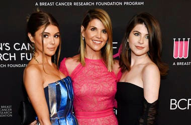 """In this Feb. 28, 2019 file photo, actress Lori Loughlin, center, poses with daughters Olivia Jade Giannulli, left, and Isabella Rose Giannulli at the 2019 """"An Unforgettable Evening"""" in Beverly Hills, Calif. Loughlin and her husband Mossimo Giannulli were"""