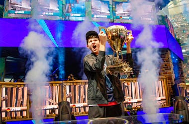"In this Sunday, July 28, 2019 photo provided by Epic games, Kyle Giersdorf reacts after he won the Fortnite World Cup solo finals in New York. Giersdorf, of Pottsgrove, Pa. who goes by the name ""Bugha"" when competing, racked up the most points and won $3"