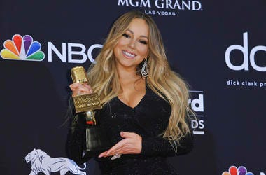 Mariah Carey poses in the press room with the Icon award at the Billboard Music Awards at the MGM Grand Garden Arena in Las Vegas