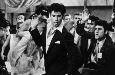 John Travolta struts his stuff in the hit musical film 'Grease'