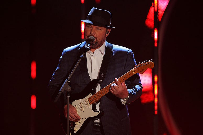 Christopher Cross on stage with a guitar