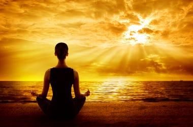 Yoga Meditating Sunrise, Woman Mindfulness Meditation on Beach