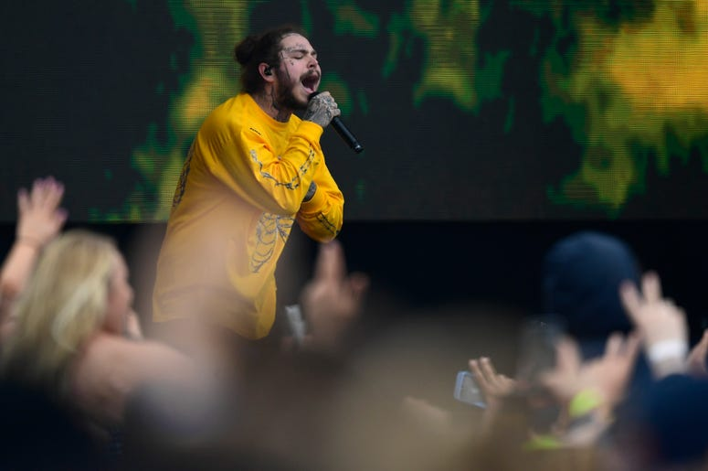 American rapper Post Malone performs in the infield prior to the running of the 143rd Preakness Steaks at Pimlico Race Course