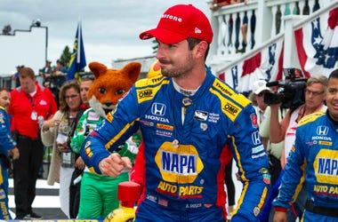 Aug 19, 2018; Long Pond, PA, USA; Verizon IndyCar Series driver Alexander Rossi celebrates in victory lane after winning the ABC Supply 500 at Pocono Raceway.