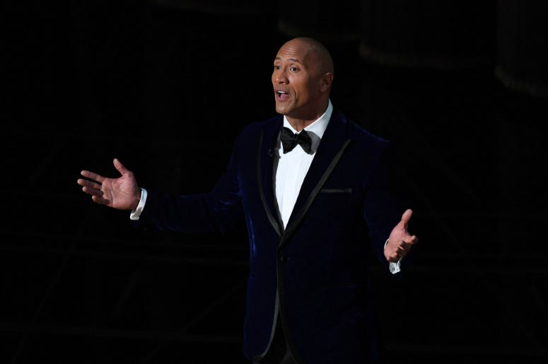 """Dwayne """"The Rock"""" Johnson introduces Lin Manuel Miranda and Auli'i Cravalho as they perform 'How Far I ll Go' from 'Moana' during the 89th Academy Awards at Dolby Theatre."""