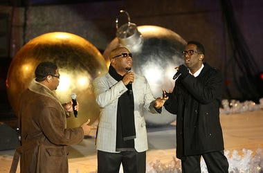 Boyz II Men perform on stage at the Rockefeller Center Christmas tree lighting