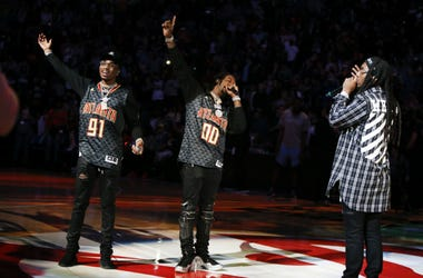 Quavo and Offset and Takeoff from the hip-hop group Migos performs during halftime of a game between the Memphis Grizzlies and Atlanta Hawks.