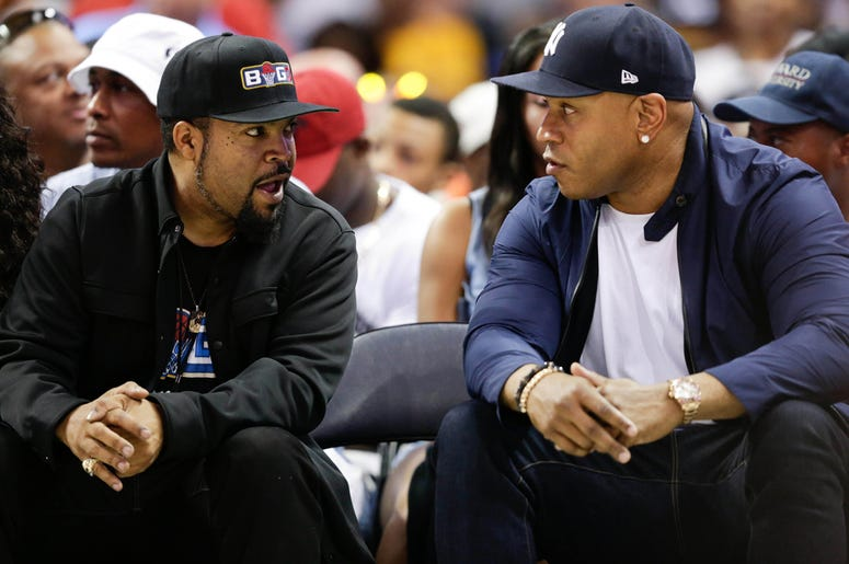 Jul 2, 2017; Charlotte, NC, USA; Movie actor Ice Cube and actor LL Cool J talk during the game between 3's Company and Ghost Ballers at Spectrum Center. Mandatory Credit: Jeremy Brevard-USA TODAY Sports