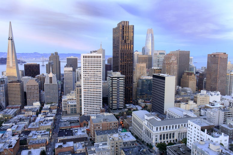 Aerial view of San Francisco Financial District as seen from a building rooftop in Nob Hill at dusk. (Photo credit: Yuval Helfman/Dreamstime)