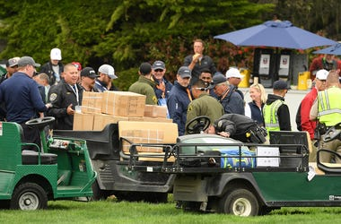 PEBBLE BEACH, CALIFORNIA - JUNE 14: A golf cart loaded with boxes, which was involved an incident, is inspected on the 16th hole during the second round of the 2019 U.S. Open at Pebble Beach Golf Links on June 14, 2019 in Pebble Beach, California. (Photo