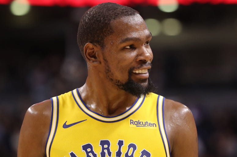 Nov 29, 2018; Toronto, Ontario, CAN; Golden State Warriors forward Kevin Durant (35) smiles as he reacts during their defeat to the Toronto Raptors at Scotiabank Arena. The Raptors beat the Warriors 131-128 in overtime. Mandatory Credit: Tom Szczerbowski-