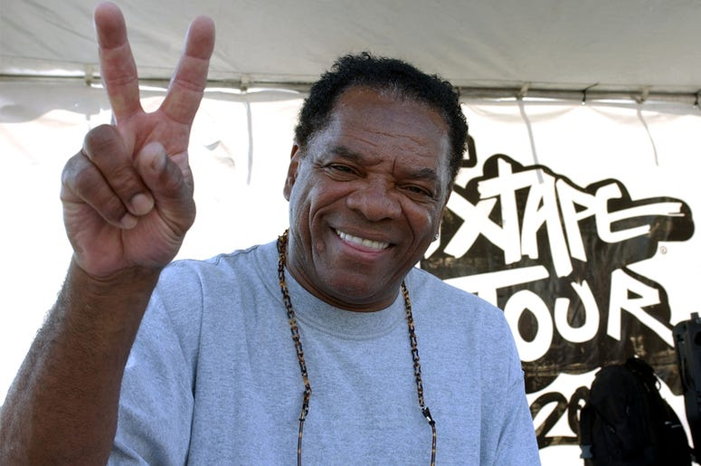 John Witherspoon looks on as Los Angeles Street Ballers compete for the chance to play against the 2004 Team AND1 on the blacktop of the The Great Western Fourm in Inglewood, California June 9, 2004. (Photo by Steve Grayson/WireImage)
