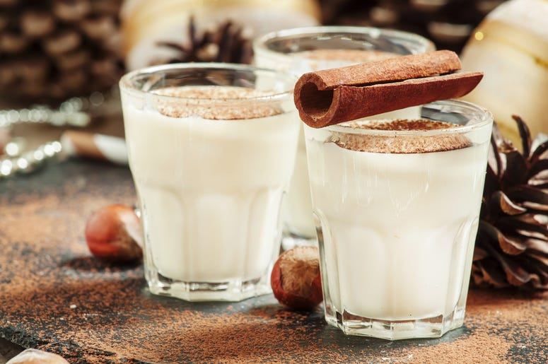 Eggnog with milk, cinnamon, grated nutmeg, decorated with fir co. Drink, alcoholic. (Photo credit: Olga Kochina/Dreamstime)