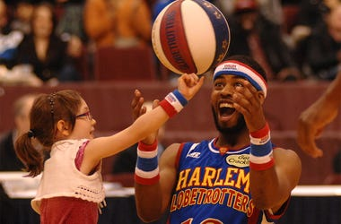 "Harlem Globetrotters' player Ant entertains a girl during their 2014 ""Fans Rule"" World Tour basketball show on Feb.13, 2014 in Vancouver, Canada. The Harlem Globetrotters are an exhibition basketball team that combines athleticism, theater and comedy. Ove"