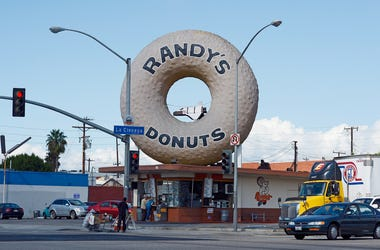 LOS ANGELES, CA - OCTOBER 10: A toy space shuttle placed in the dounut hole of Randy's Donuts in preparation of the ground transport of the space shuttle Endeavour on October 10, 2012 in Los Angeles, California. The orbitor will stop in front of the donut