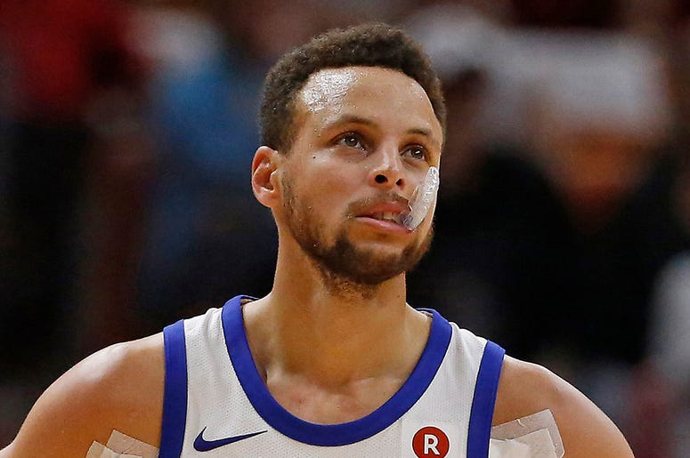 Golden State Warriors guard Stephen Curry looks on during the second quarter against the Miami Heat on Sunday, Dec. 3, 2017 at AmericanAirlines Arena in Miami, Fla. (Photo by David Santiago/Miami Herald/TNS/Sipa USA)