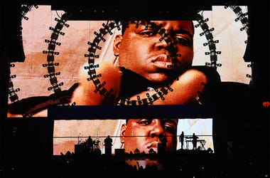 LAS VEGAS, NV - SEPTEMBER 19: Images of the late rapper The Notorious B.I.G. are shown during a performance by recording artist Sean 'Puff Daddy' Combs at the 2015 iHeartRadio Music Festival at MGM Grand Garden Arena on September 19, 2015 in Las Vegas, Ne