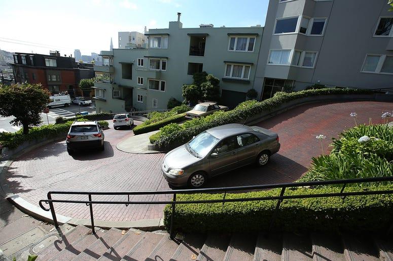 SAN FRANCISCO, CA - MAY 20: Cars drive down Lombard Street on May 20, 2014 in San Francisco, California. The San Francisco Municipal Transportation Agency Board of Directors is considering a summer shutdown San Francisco's famed Lombard Street, known as t