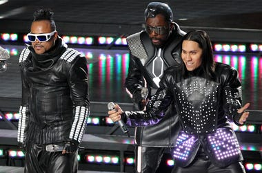 Feb 6, 2011; Arlington, TX, USA; Black Eyed Peas recording artists Fergie (not pictured), Apl.De.Ap (second left), Will.I.Am (second right) and Taboo (right) perform during halftime of Super Bowl XLV between the Green Bay Packers and Pittsburgh Steelers a