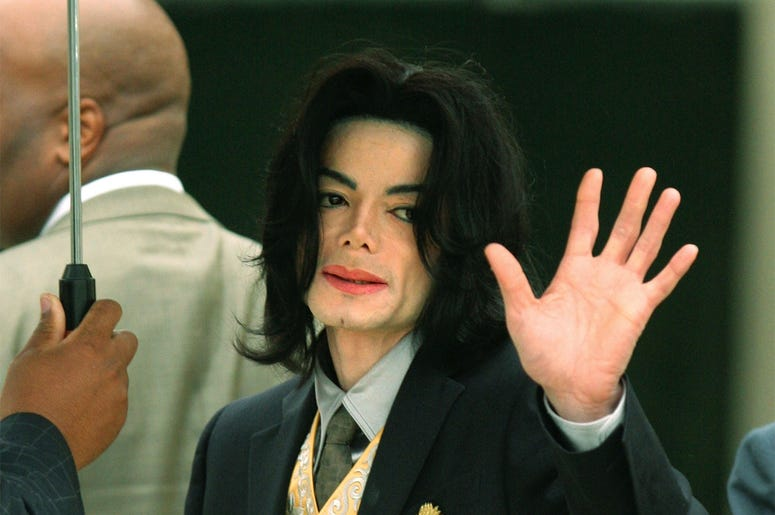 SANTA MARIA, CA - MAY 25: Singer Michael Jackson waves as he arrives at the Santa Barbara County Courthouse for his child molestation trial May 25, 2005 in Santa Maria, California. Jackson is charged in a 10-count indictment with molesting a boy, plying h