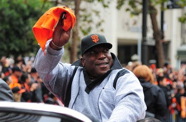 October 31, 2012; San Francisco, CA, USA; San Francisco Giants former first baseman Willie McCovey waves to the crowd while riding in a car during the World Series victory parade at Market Street. The Giants defeated the Detroit Tigers in a four-game swee
