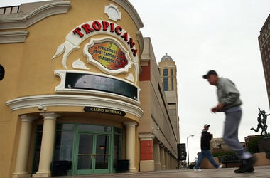 ATLANTIC CITY, NJ - APRIL 29: A man runs by the Tropicana Casino Resort on April 29, 2009 in Atlantic City, New Jersey. It was announced on Wednesday that New Jersey regulators have approved plans to auction the Tropicana Casino Resort in Atlantic City th