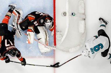 Anaheim Ducks center Ryan Kesler, left, blocks a shot by San Jose Sharks left wing Evander Kane