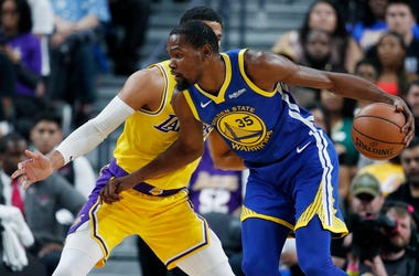 Golden State Warriors forward Kevin Durant drives against Los Angeles Lakers guard Josh Hart