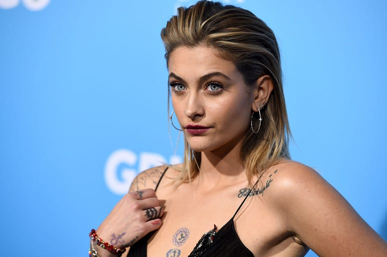 "In this March 6, 2018 file photo, Paris Jackson arrives at the Los Angeles premiere of ""Gringo"" at Regal L.A. Live. Paris Jackson has posted an online tribute to her grandfather, Joe Jackson, who died at the age of 89. On Instagram, the 20-year-old shared"